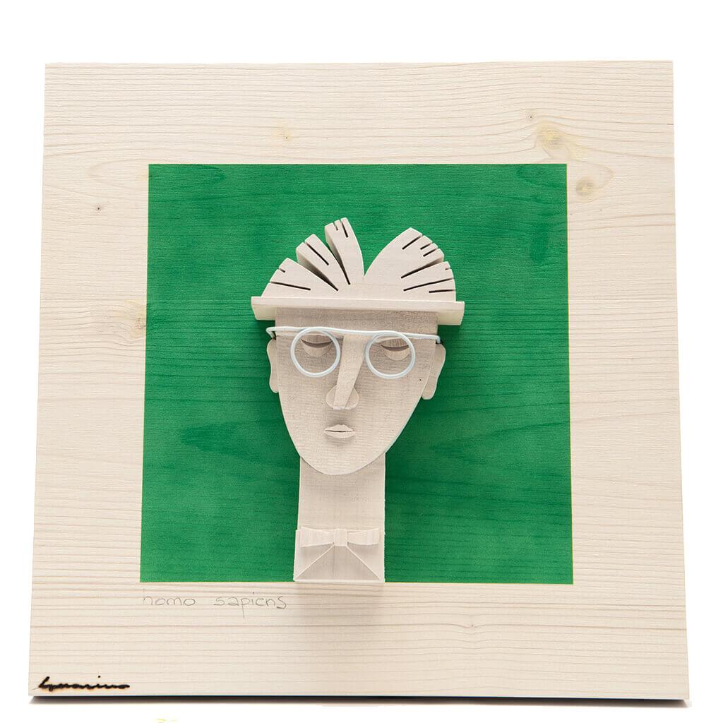 Scultura Guasina in legno - Pannello Volto su fondo verde - Homo Sapiens - dimensioni cm. 30 x 6 x 30